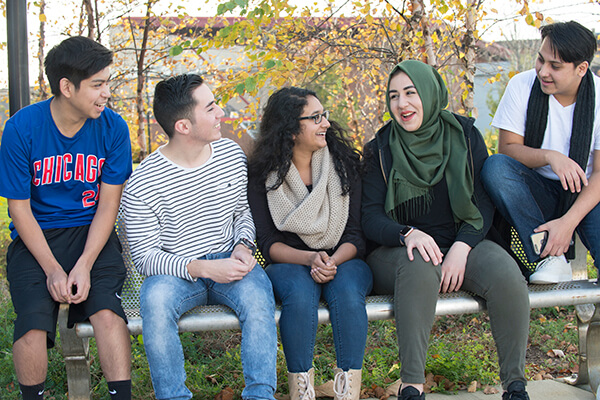 International students on a bench