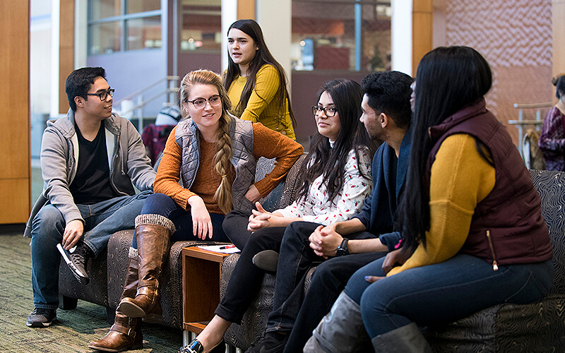 Students sitting together in lounge area.