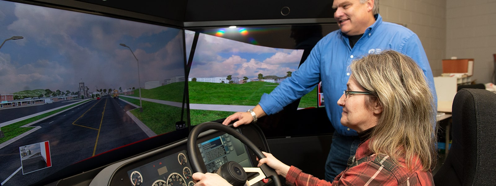 Image of student and instructor using simulator