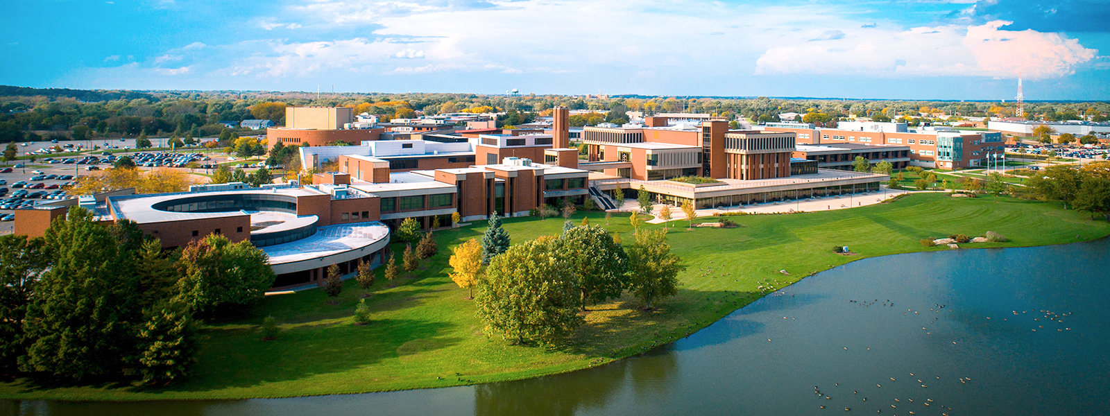 Arial photo of the ECC campus with a view of Lake Spartan